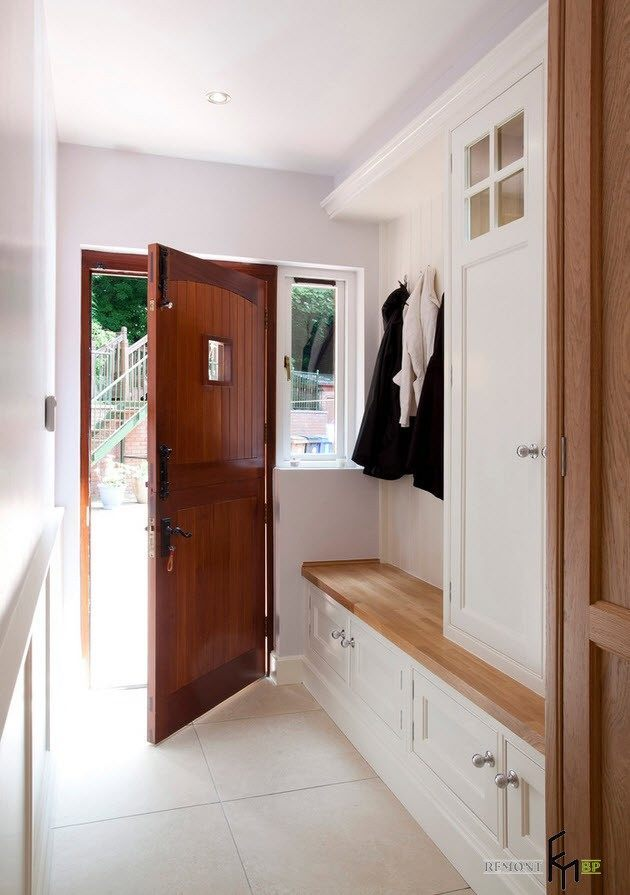 Nice white hall with wooden elements