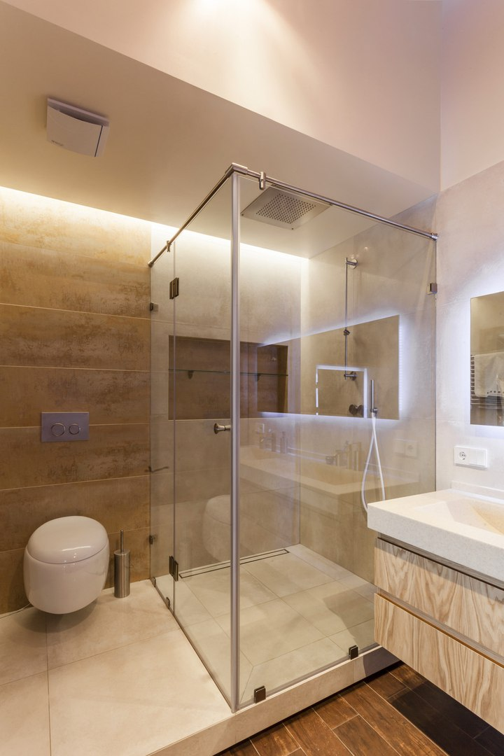 "Modern Industrial Style Design of Kiev Apartment. Very modern construction of the bathroom with glass panels and ""hovering"" toilet"
