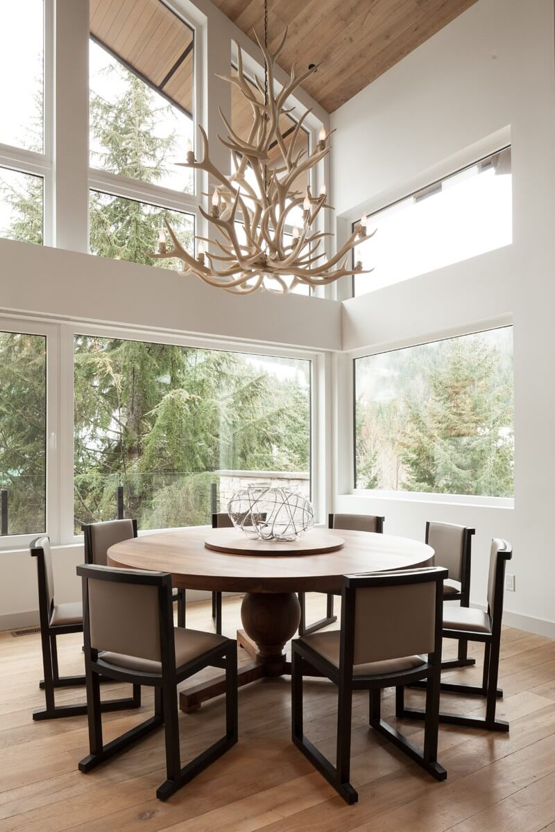 Nice dining group with original design of the chandelier in the form of peculiar antlers