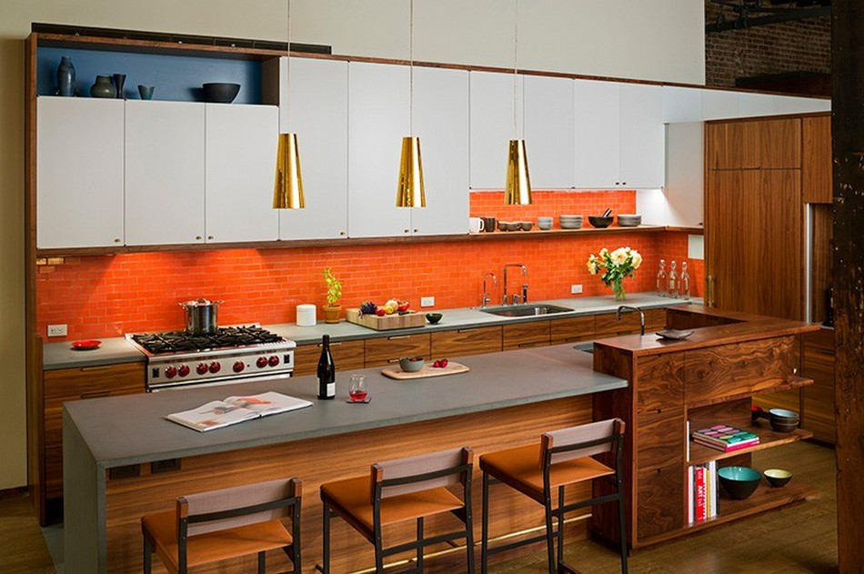 New York Loft Apartment of Former Warehouse. Dining zone with the orange backsplash
