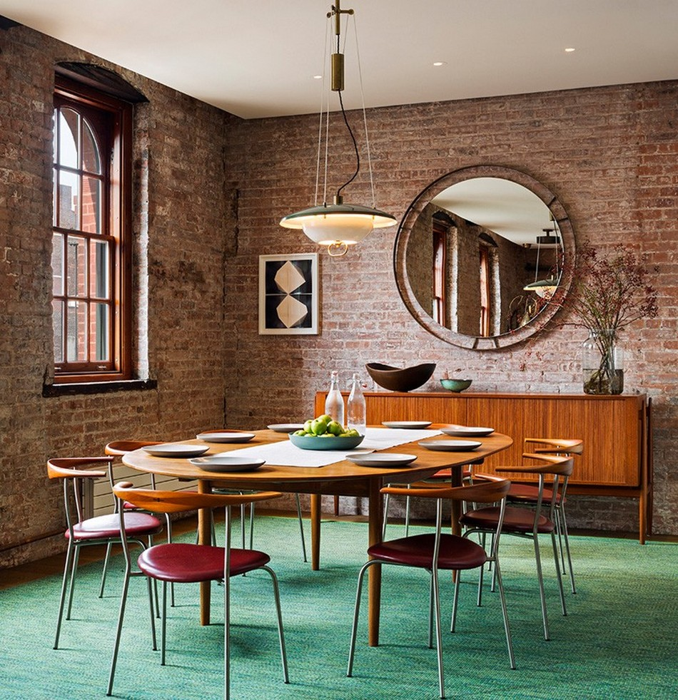 New York Loft Apartment of Former Warehouse. Brickwork and round mirror in the living room