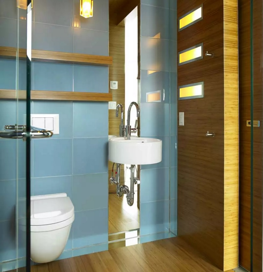 Minimalistic decorated bathroom with nice marine hue of the accent wall