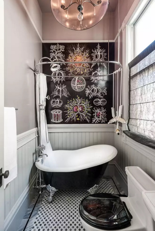 Dark vintage design for the very tight bathroom space with the bright pictures at the walls