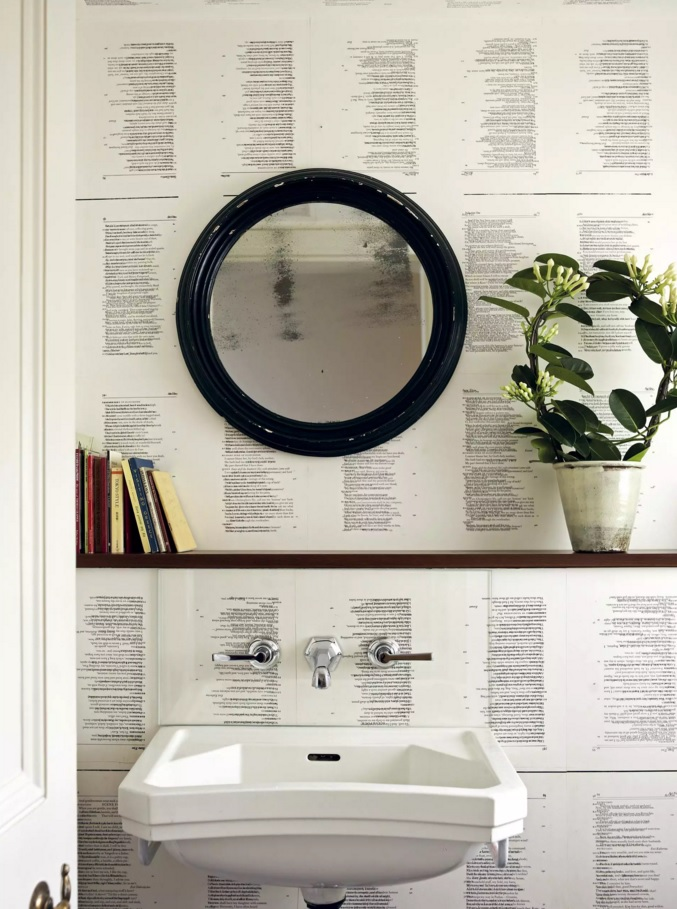 Wallpaper with newspaper pattern and eco elements in the design of bathroom
