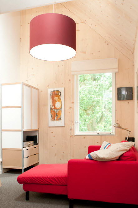 Grass Roof House Bold Design Project. Bright vivid bedroom with red furniture
