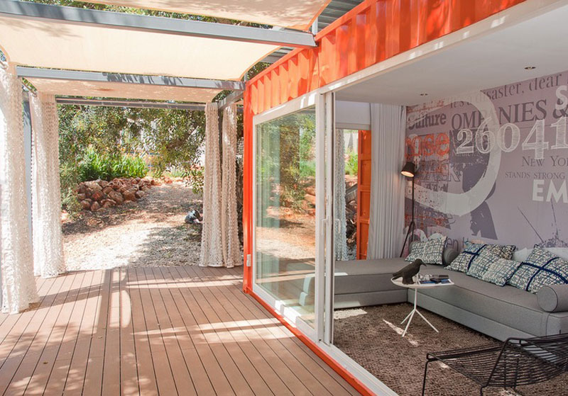 Cargo Container House Design Ideas. Glass panels and a terrace with wooden floor cover
