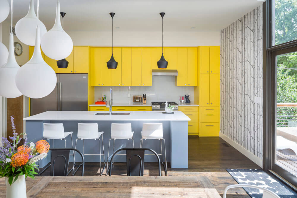 Bright Interior Design Ideas for Private House. Light vivid yellow kitchen with the dining area