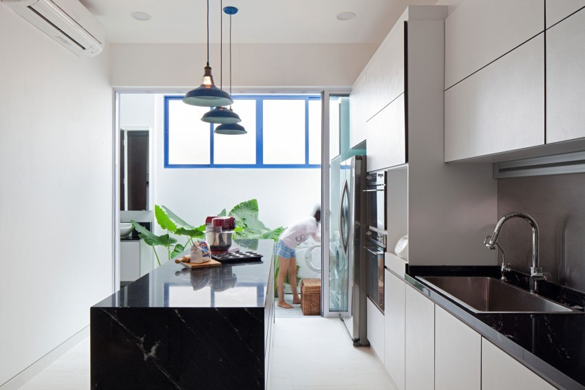 Original Compact Private House Design. Kitchen full of light and with pendant lamps over the island