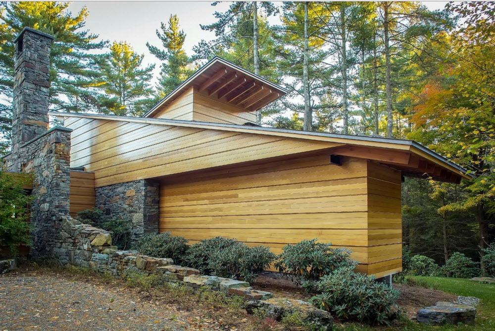 Backyard view of the wooden house`s facade
