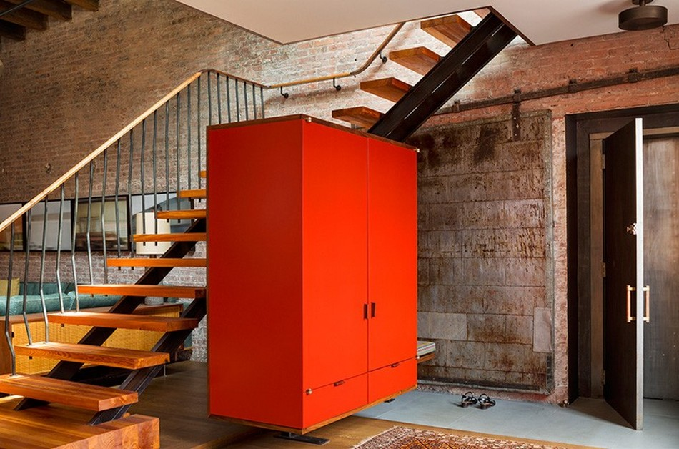 New York Loft Apartment of Former Warehouse. Red cabinet in the entry