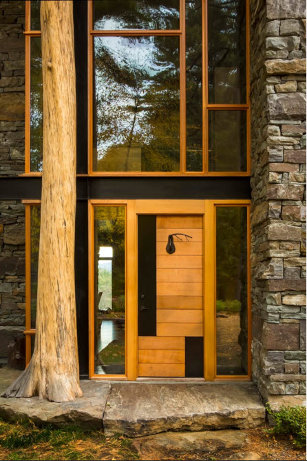 Modern Country Style Rural House. Glass entry door and the porch