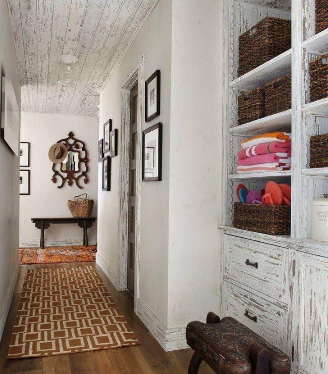 Hallway in white full of storage