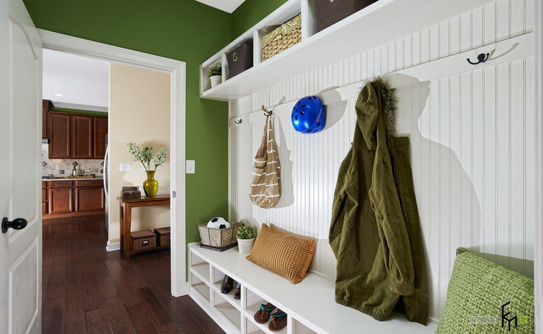 Bright hall design with green painting of the walls