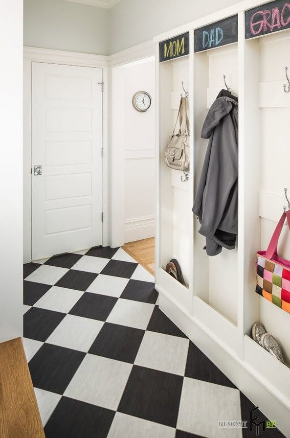 white and black checkered floor design in the white trimmed entry