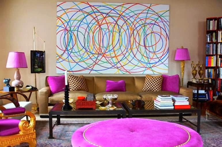 Fusion living room with pink fluffy ottoman and cushions