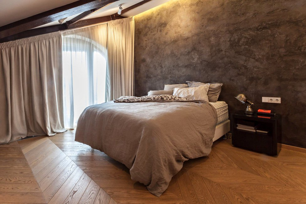 Modern Industrial Style Design of Kiev Apartment. Master bedroom with texture plaster of dark brown and gold gradient