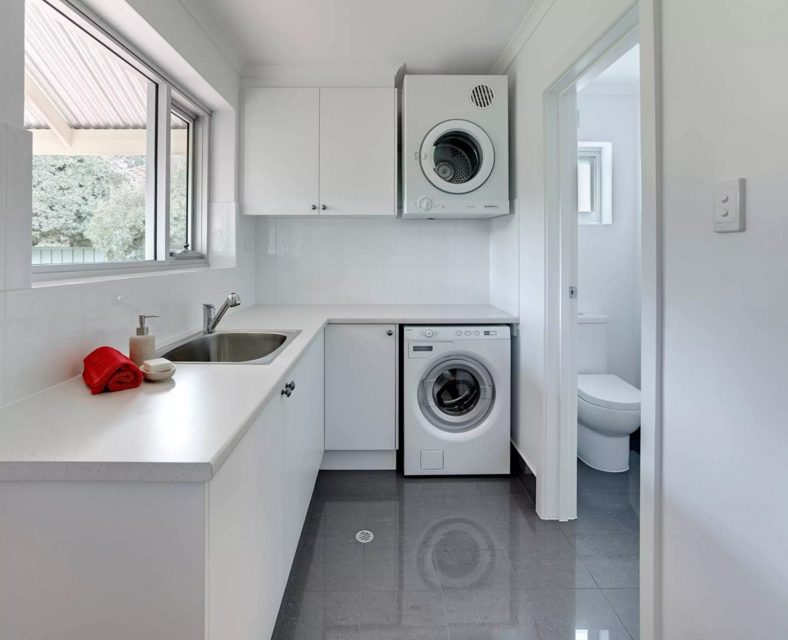 Functional and Beatiful Laundry Interior Ideas. Neat snowy atmosphere in the economic room