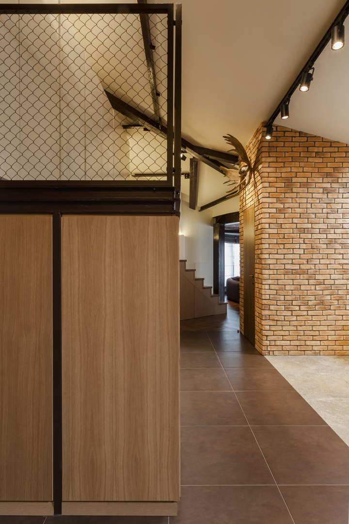 Modern Industrial Style Design of Kiev Apartment. Hallway and the entrance to the upper level