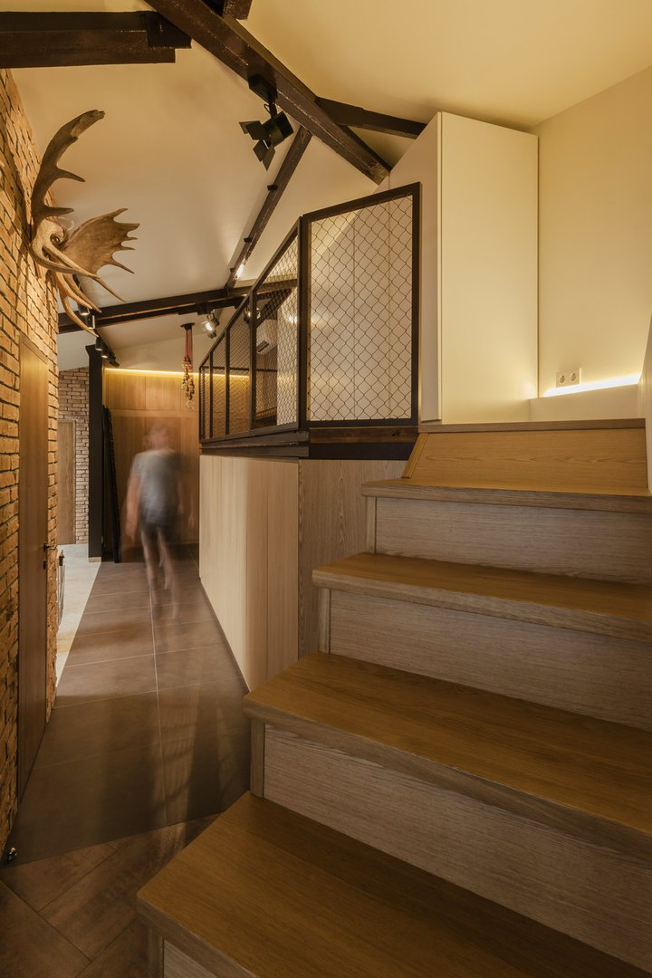 Modern Industrial Style Design of Kiev Apartment. Broad hallway with stairs