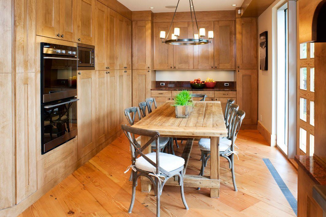 100 Kitchen Chairs Design Ideas. Totally wooden interior in Classic style with candle round chandelier