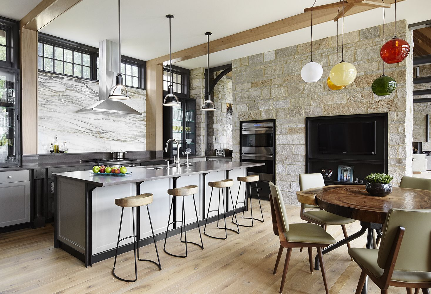 Nice white island with high bar stools for the high spacious provate house kitchen
