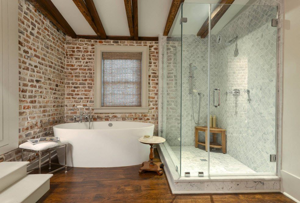 Glass bathroom cabin  in the brickwork trimmed space