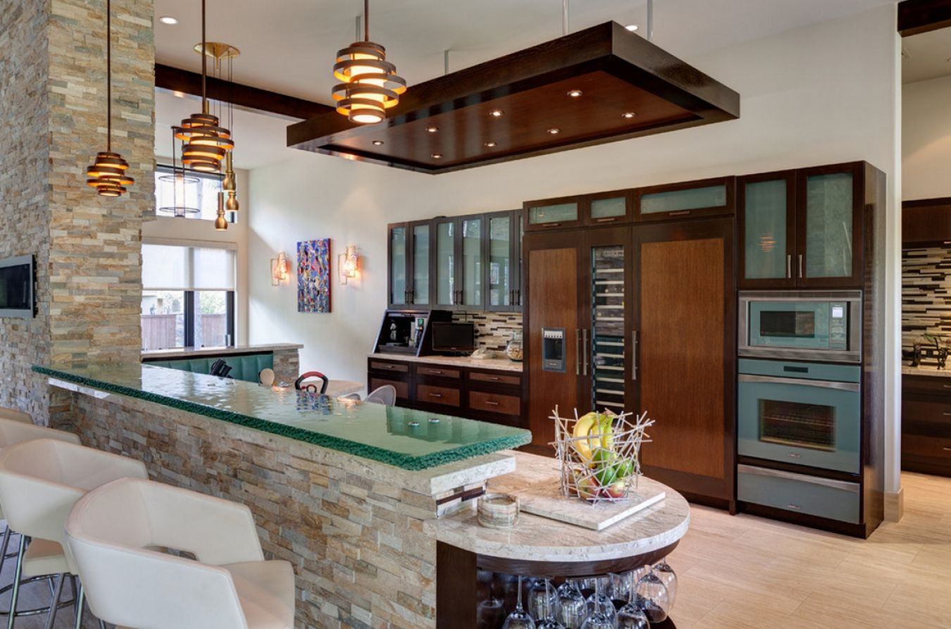 Wooden and stone decoration of the rich furnished kitchen