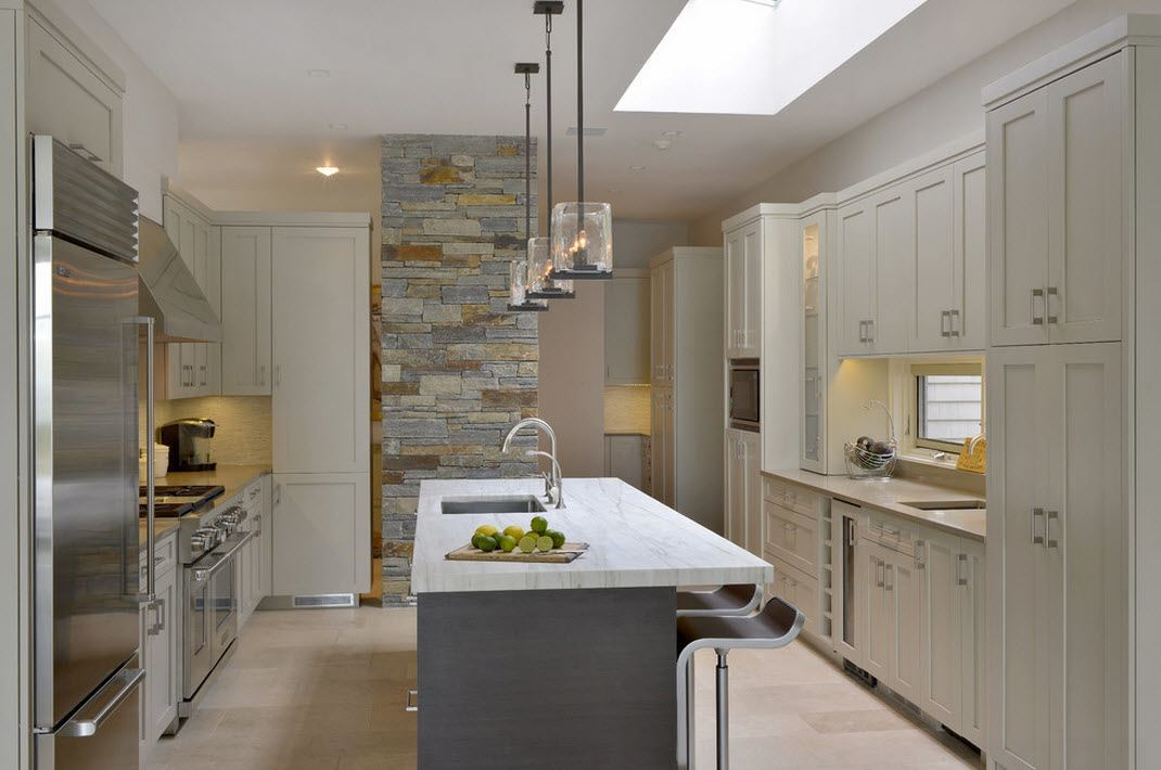 Original kitchen design with the usual lamps in glass frames and pastel color decoration