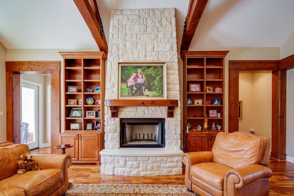 Top Ceiling Beams Design Photo Ideas. Classically trimmed modern business looking library with the fireplace