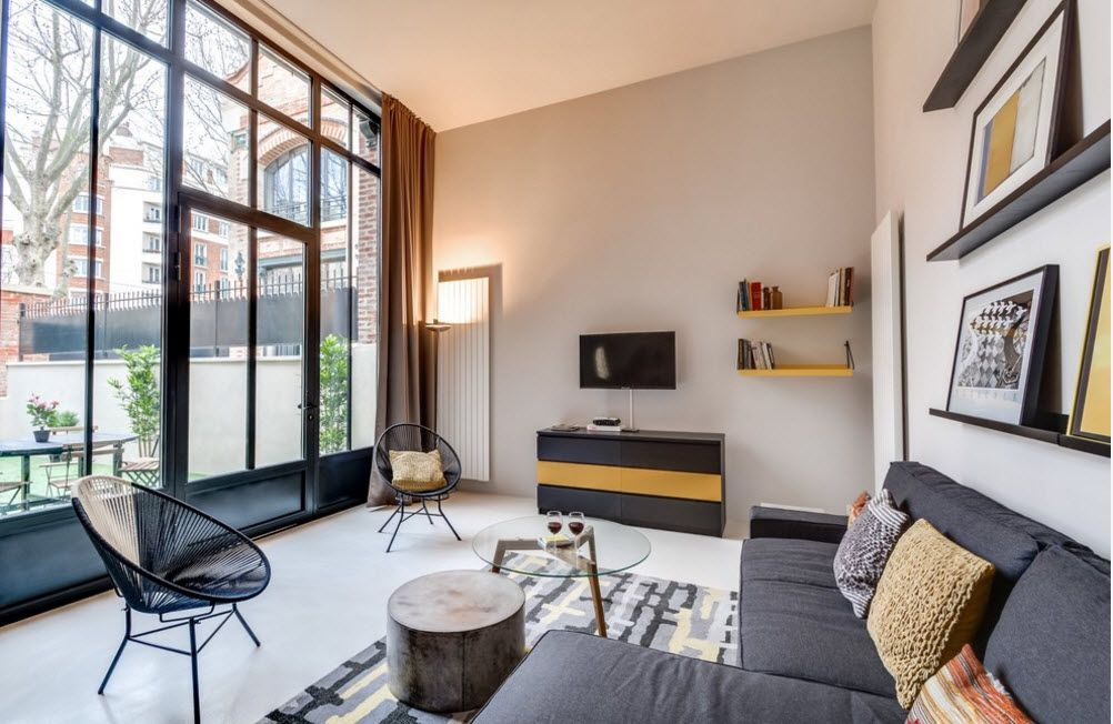 Original Industrial Apartment Design Project. Homey ambience of the room