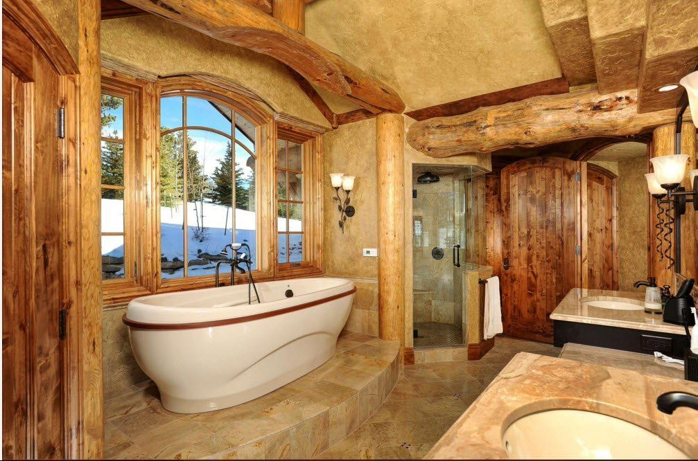 Rough treated logs as the ceiling constructions of the bathroom