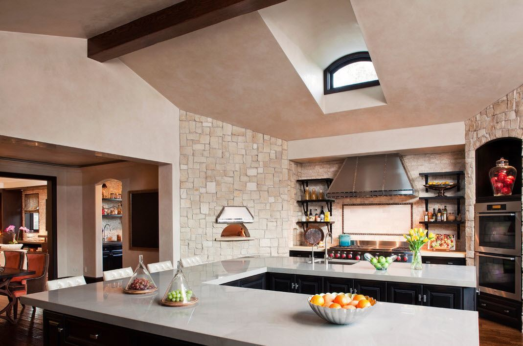 Light trimmed country styled kitchen with skylight