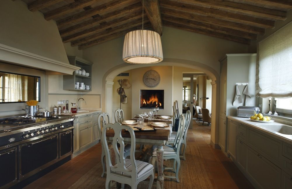 100 Kitchen Chairs Design Ideas. Dark Provence entourage with wooden ceiling beams and bright splashes of furniture