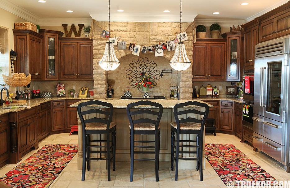 Stone Kitchen Interior Decoration Ideas. High black wooden stools at the island