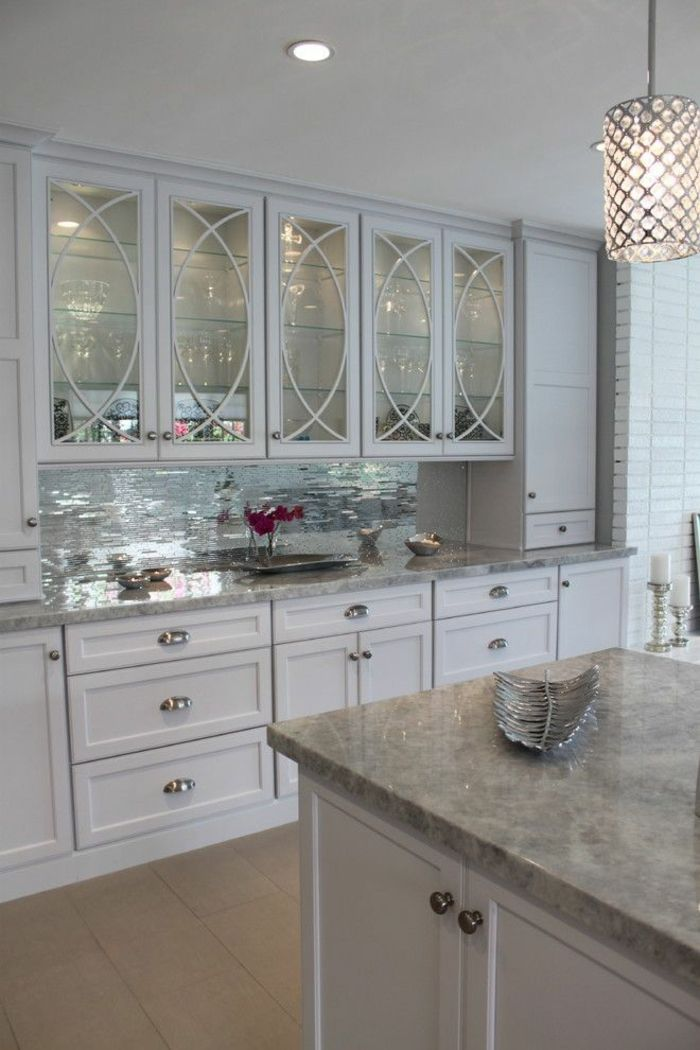 Mirror Tiles Ideas for Modern Interior Design. White facades of the kitchen blend well with the mirror surfaces of the tile