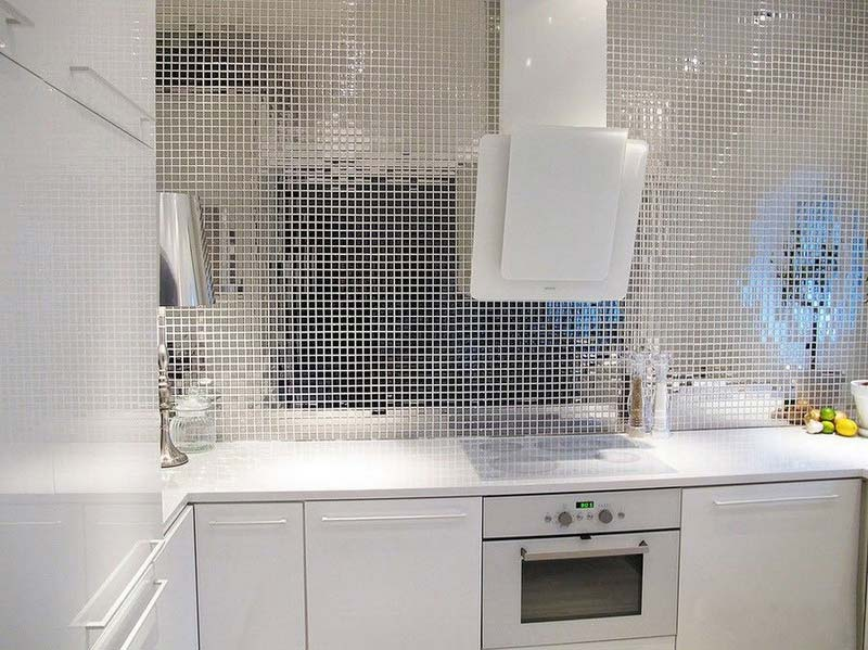 Mirror Tiles Ideas for Modern Interior Design. Unique extractor hood and tile installation in the kitchen