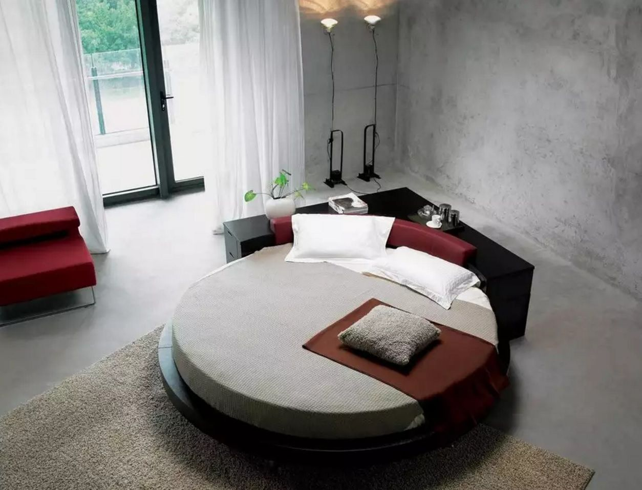 Circle Bed of Unique Bedroom Interior Design. Loft and industrial style mixing with the round bed as an accent of the overall atmosphere