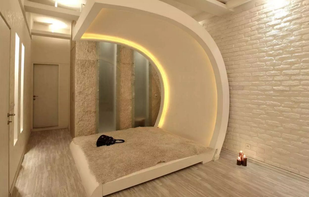 Circle Bed of Unique Bedroom Interior Design. Round bed hood with backlight looks amazing