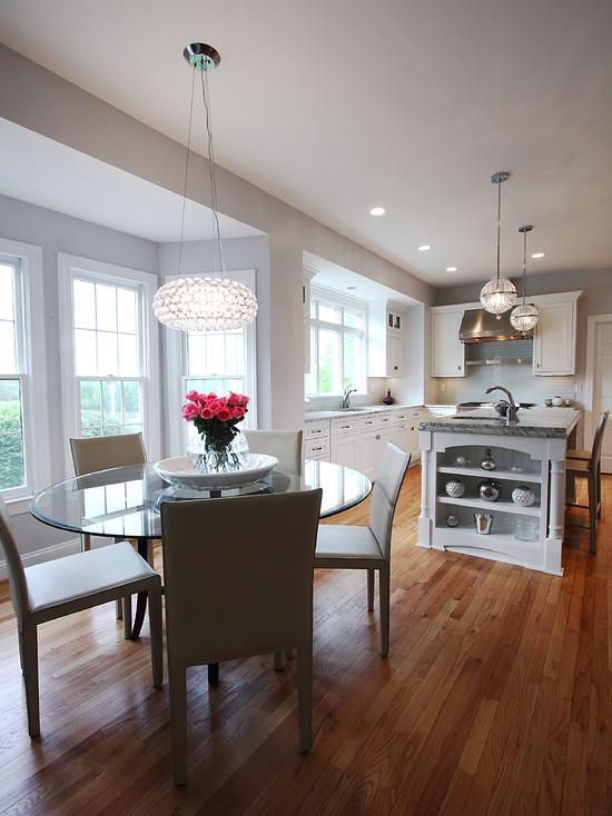 100 Kitchen Chairs Design Ideas. Round glass tablу and dining group with the wooden floor trimming all over the spacious room