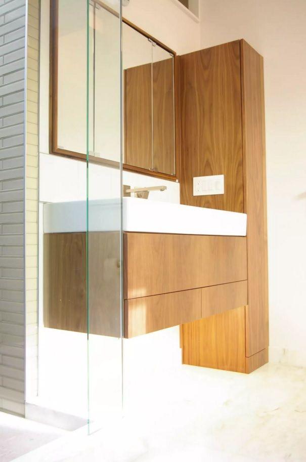 Small Bathroom Space Saving Vanity Ideas. Light wooden execution of the bathroom furniture