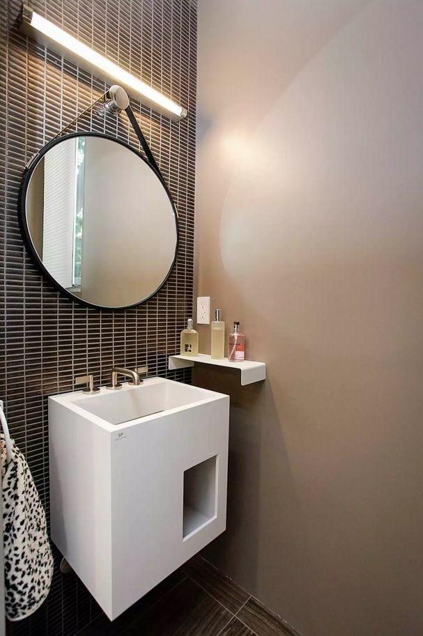 Small Bathroom Space Saving Vanity Ideas. Unique design of the sink and the storage under it as a one whole