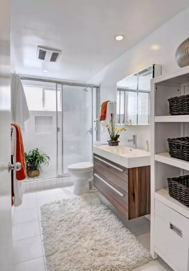 Small Bathroom Space Saving Vanity Ideas. Wooden trim of the drawer surfaces in the light utilitarian space