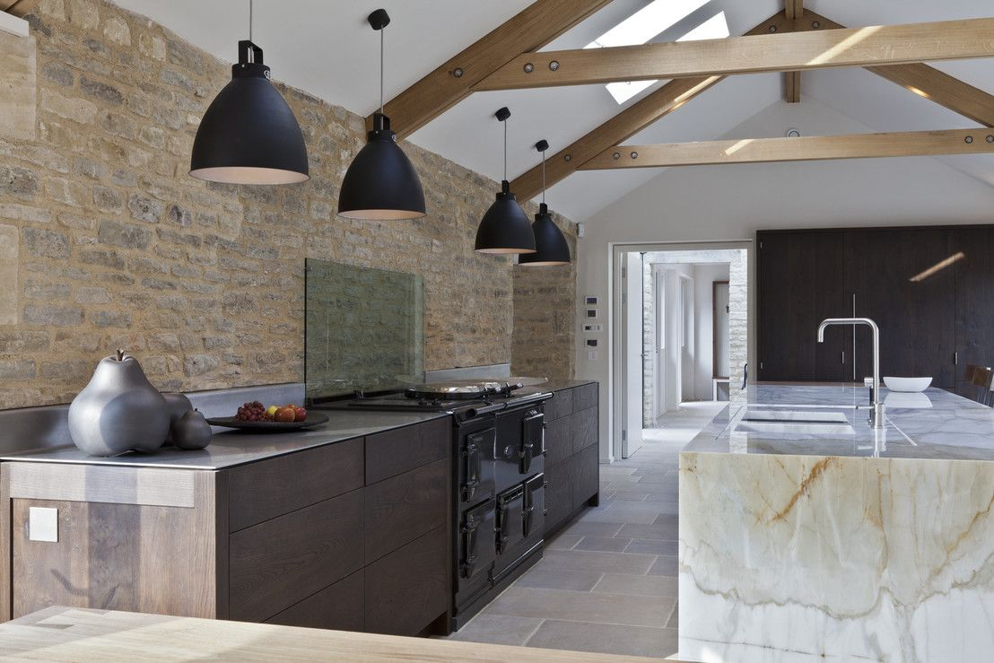 Nice pendant black lamps and open ceiling beam construction for the originallu designed kitchen