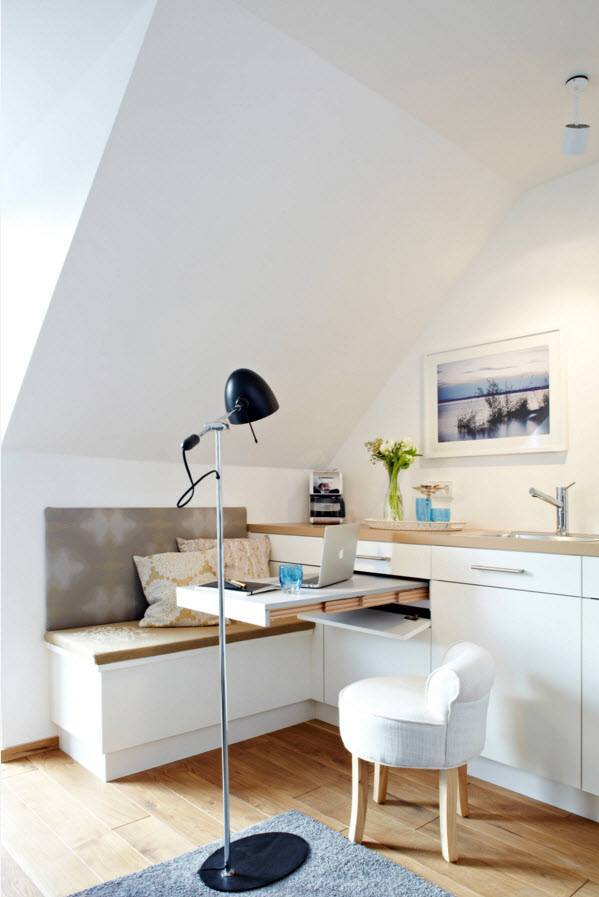 Small Apartment Light Color Design Theme. Black lamp on the working zone
