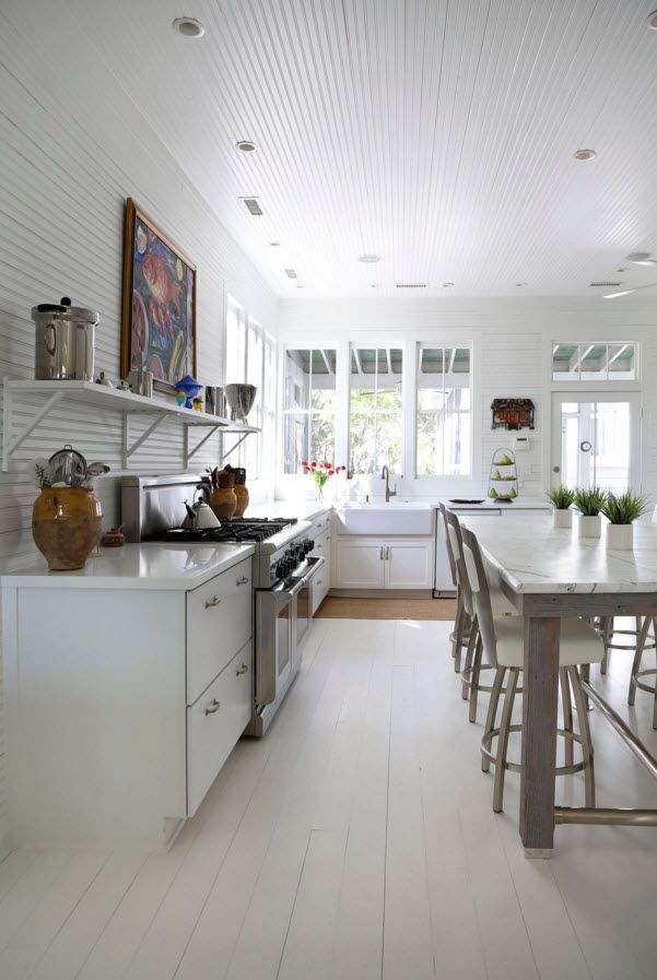 White Floor as an Exquisite Decoration Idea for Modern Interiors. Kitchen combined with dining and ornated with big picture