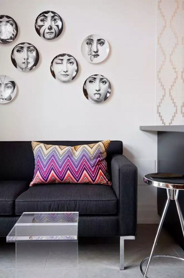 Living Room Wall Plates Decoration. Black and white composition with contrasting colorful pillow