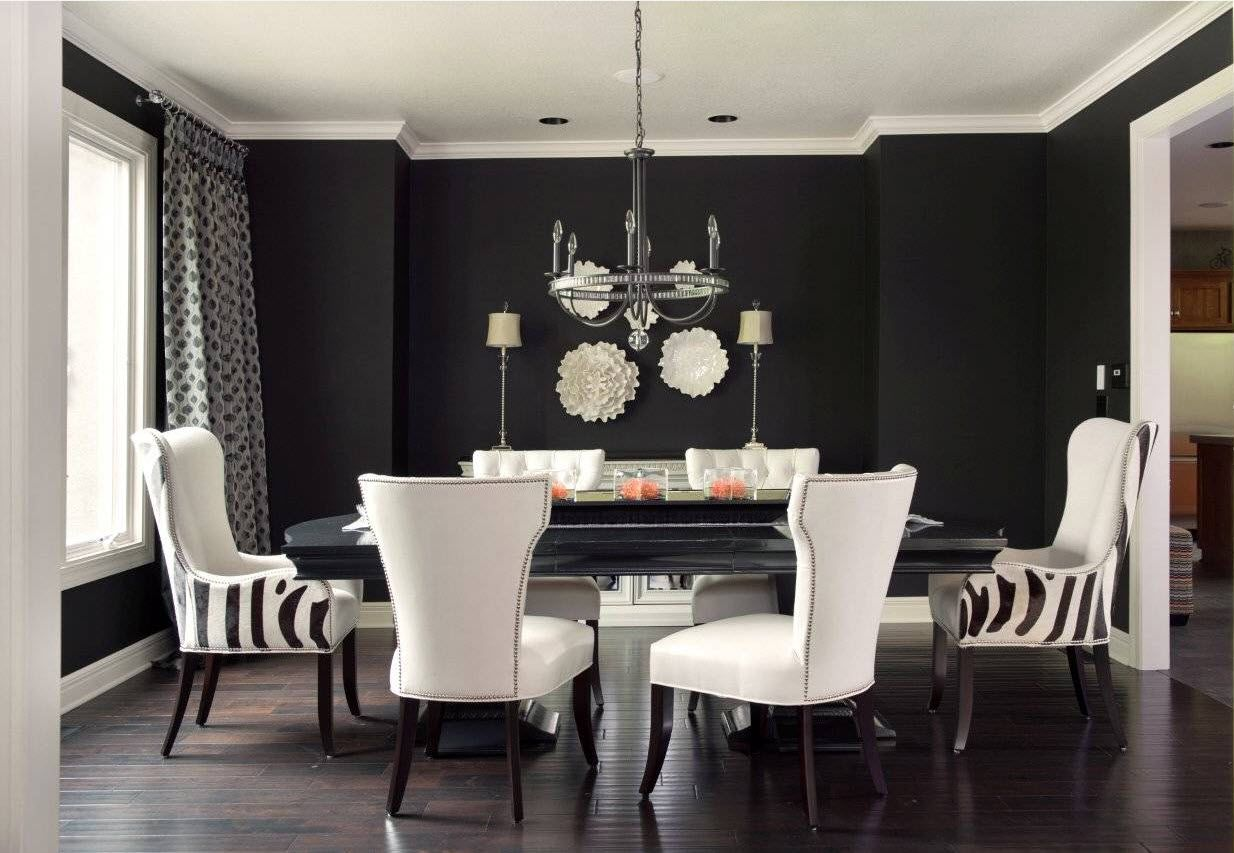 Decorative Plates on the Wall of the Dining room. Black and white decoration of the modern space