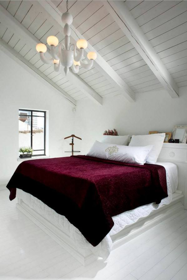Loft Style Bedroom Design at the Attic. White Veneer of the ceiling and vinous blanket