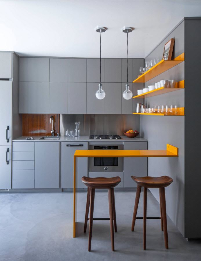 Small Grayish Toned Apartment Design Project. Unusual kitchen design with the original yellow bar-table and shelving