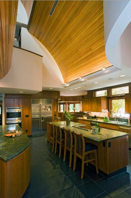 Kitchen space with high ceilings and wooden trim